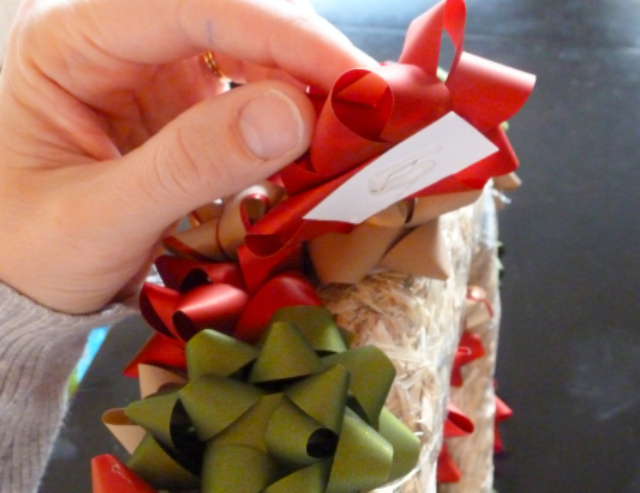 How to add hot glue to the back of the bows to make them extra secure