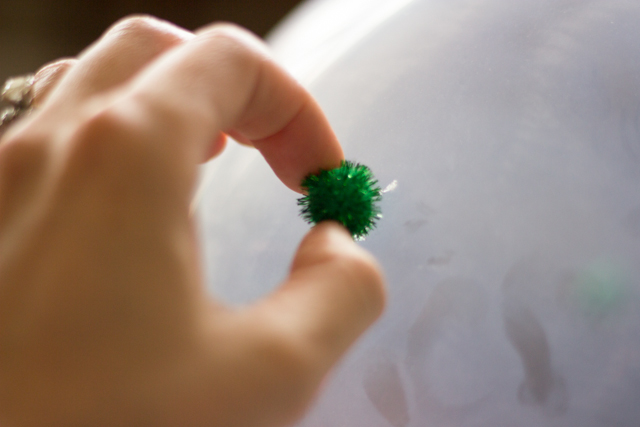 How to decorate balloons with pom-poms