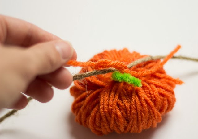 How to tie yarn pumpkins to a garland