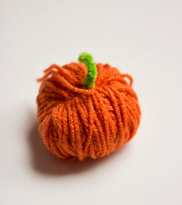 A completed yarn pumpkin