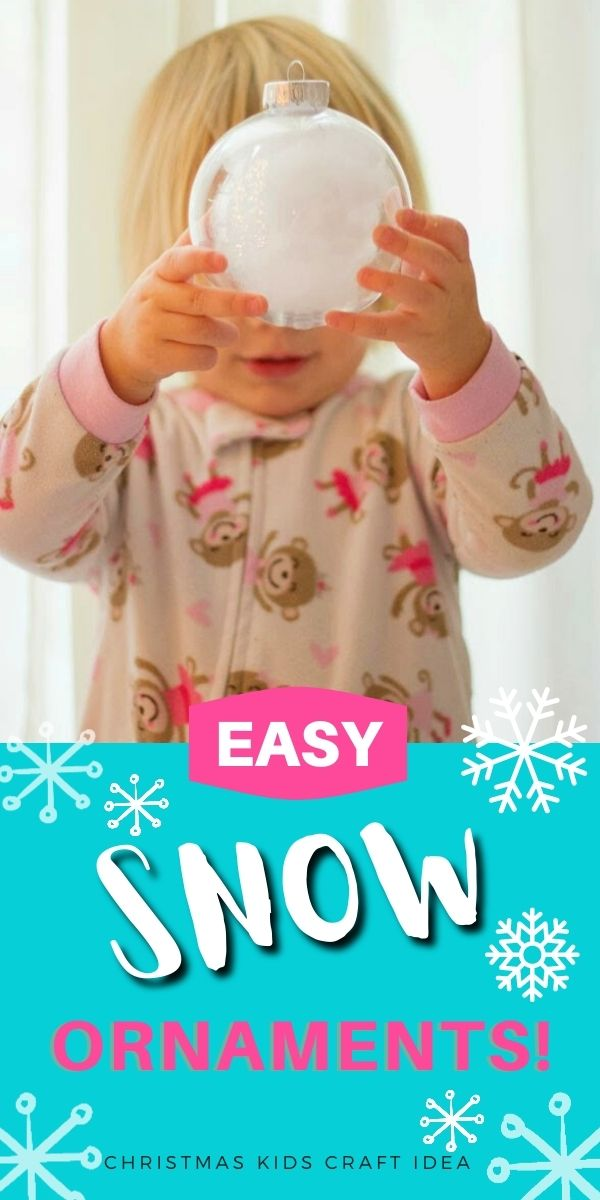 Child holding snow ornament