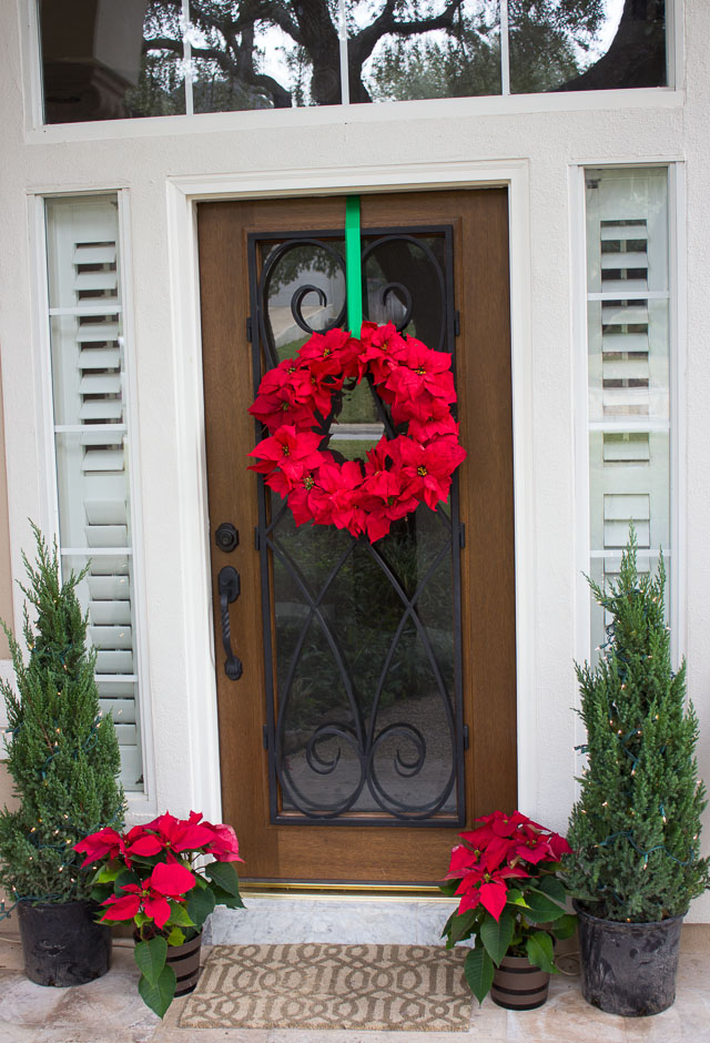 Poinsettia wreath on front door