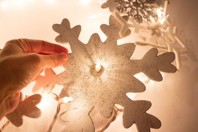 How to push the lights through the foam snowflake ornaments