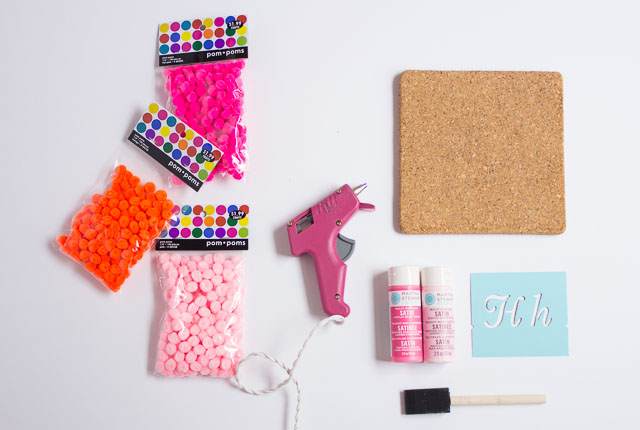 These pom pom mouse pads are made from inexpensive cork trivets! || http://www.designimprovised.com