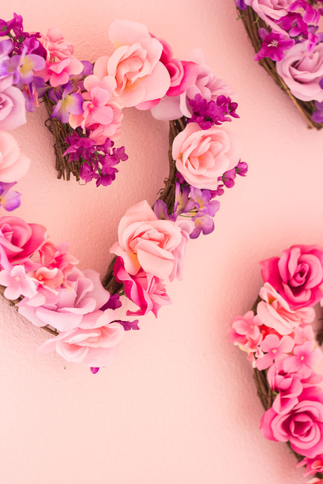 Make these beautiful floral hearts from dollar store flowers! | http://www.designimprovised.com
