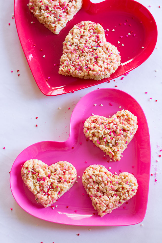 Rice Krispie Sprinkle Hearts - the perfect preschooler activity! Let them go nuts with sprinkles and then cut out with cookie cutters! | http://www.designimprovised.com