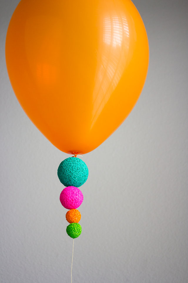 Colorful foam balls make such a cool addition to balloons!