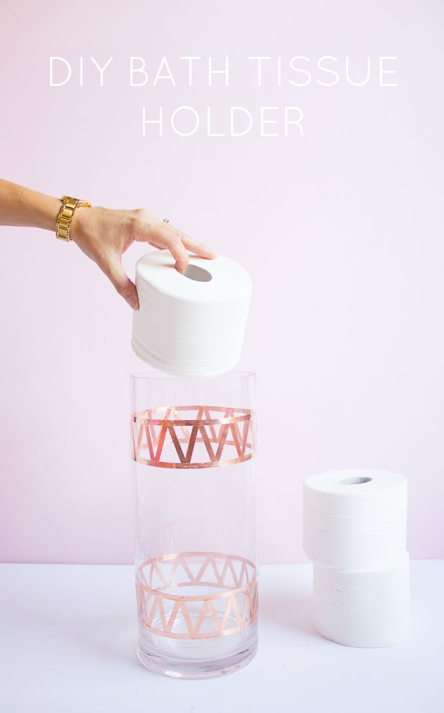Transform an old vase into chic toilet paper storage!