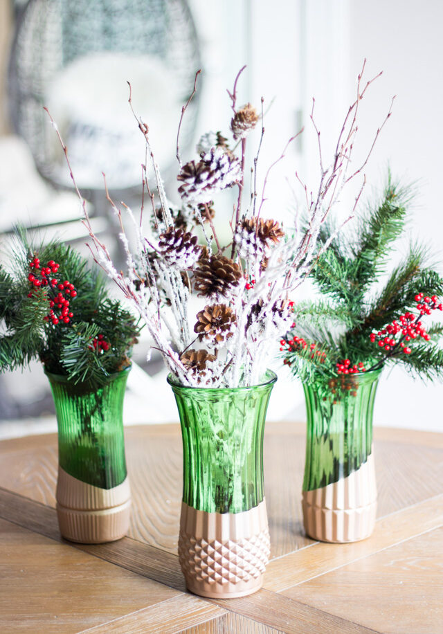 Green glass florist vases dipped in paint