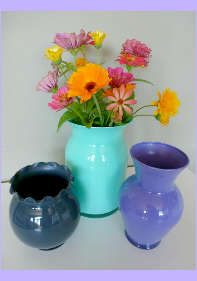 Glass vases painted different colors