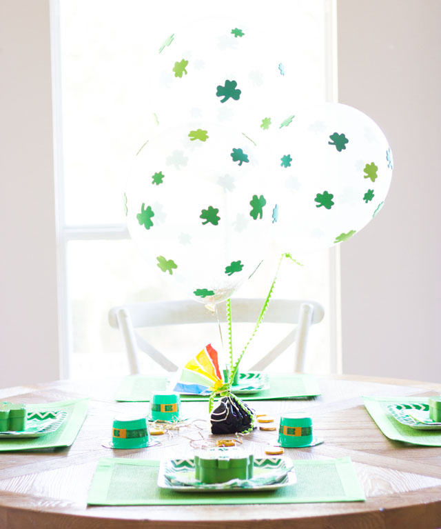 These DIY shamrock balloons are decorated with stickers! Easy enough for kids to make for a St. Patrick's day party!