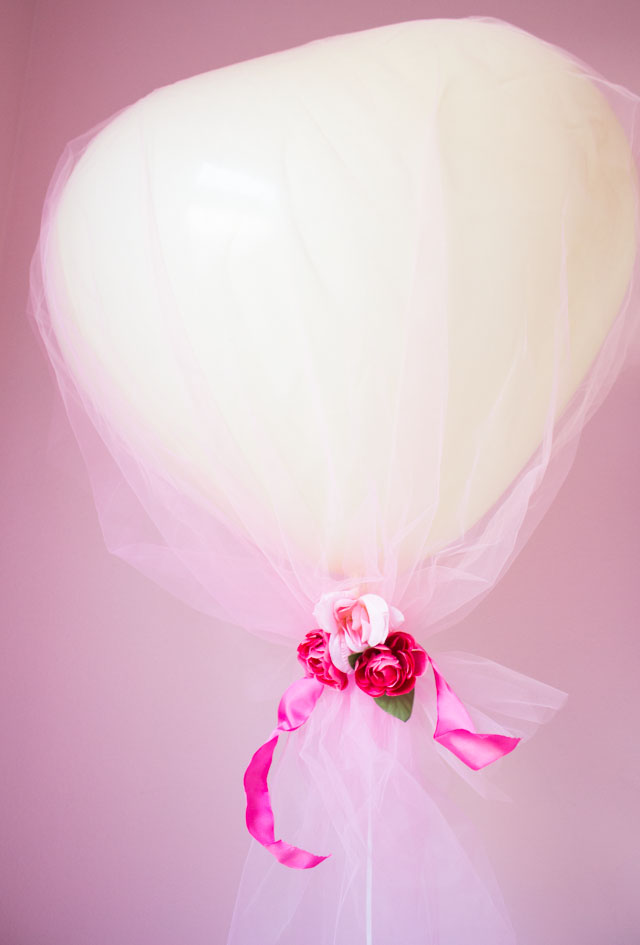Cover giant heart balloons in tulle for a gorgeous effect!
