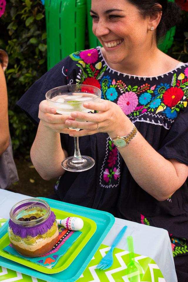 Fun Cinco de Mayo recipe idea - individual 7 layer dips in mason jars!