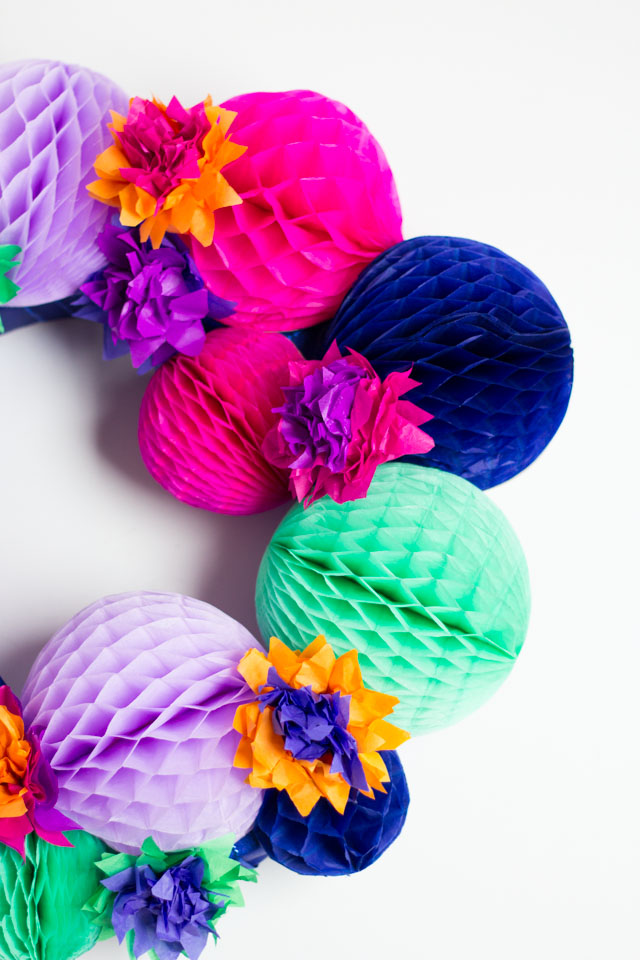 DIY fiesta wreath made with honeycomb balls and tissue paper flowers - so pretty!