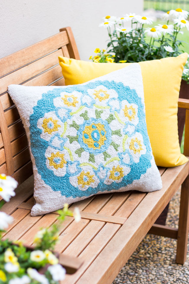Love this hand-tufted outdoor pillow! The perfect cozy touch to a patio