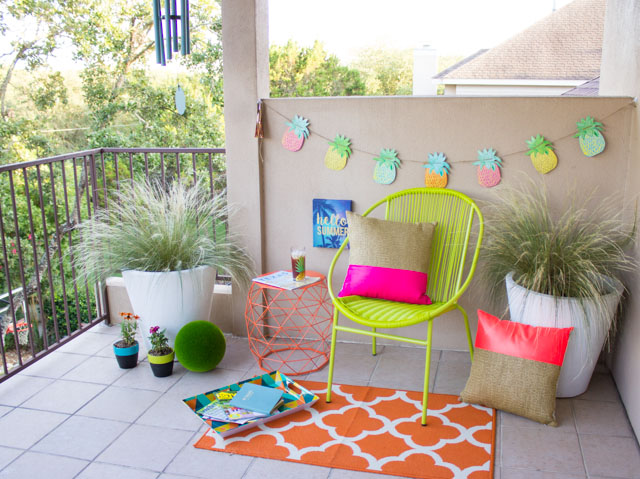 Colorful patio makeover with neon and pineapple accents!