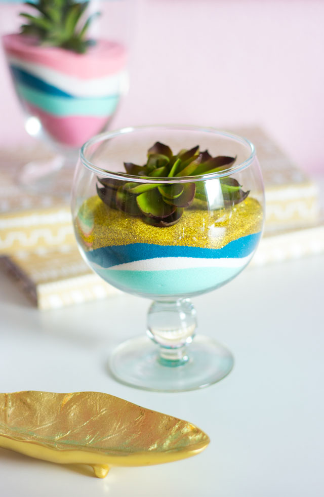 A fun sand art craft for adults - make pretty terrariums with colored sand and faux succulents!