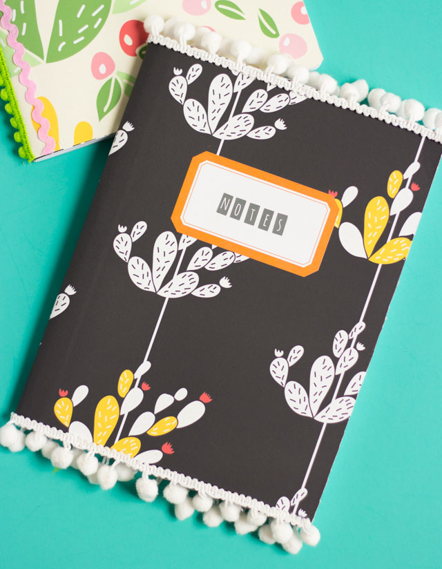 Such a fun back-to-school craft - cover composition notebooks with vinyl and pom pom trim!