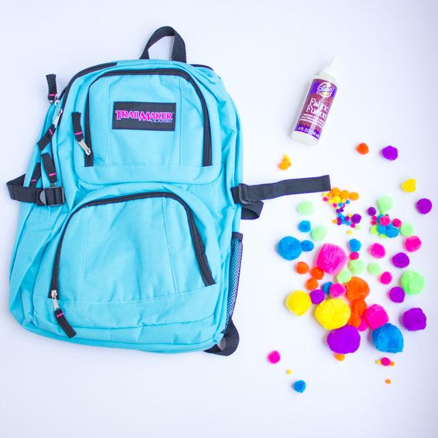 Supplies for DIY pom-pom backpack