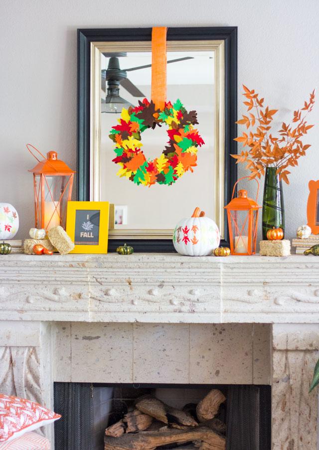 A cozy fall mantel decorating idea with a DIY felt leaf wreath!