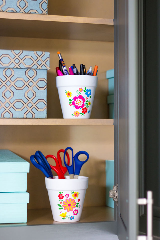 Use pretty flower pots to hold office supplies!