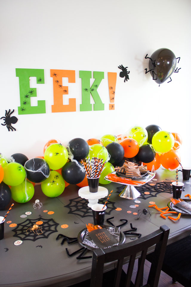 Make this spider-themed Halloween party with inexpensive supplies!