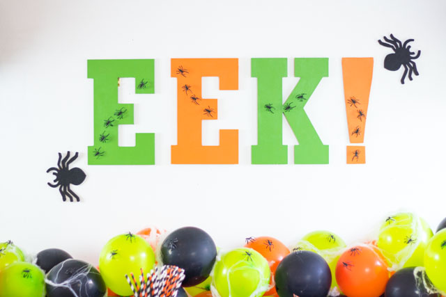 Make this EEK Halloween party sign for the perfect party backdrop!