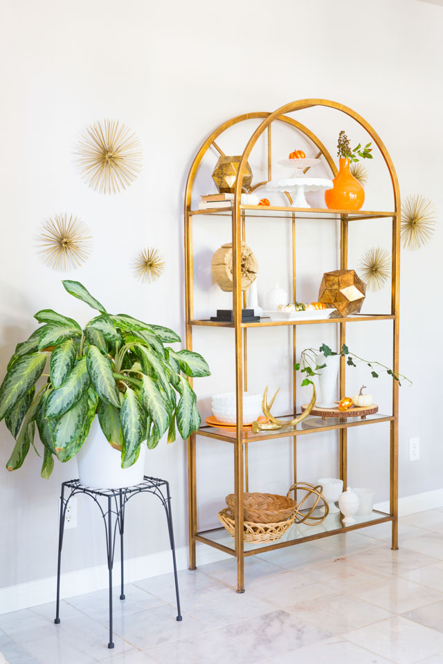 Love this gold etagere dining room storage!