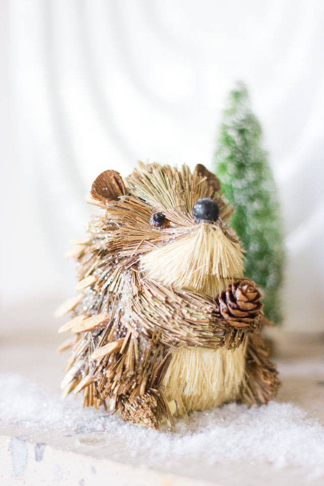 Mini hedgehog ornament in this winter woodland mantel!