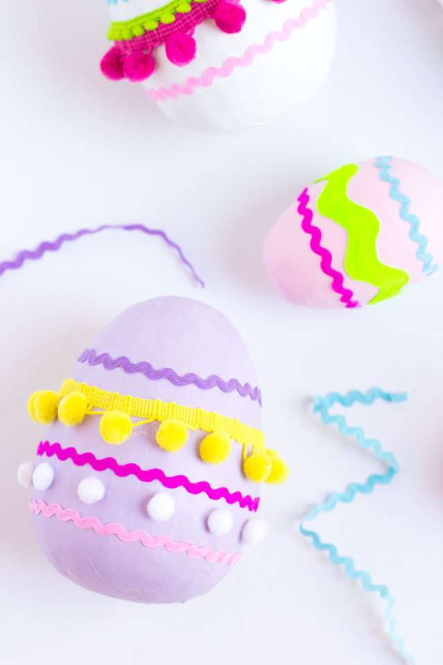 Make these colorful pom-pom and rick rack trim Easter eggs from giant paper mache eggs!