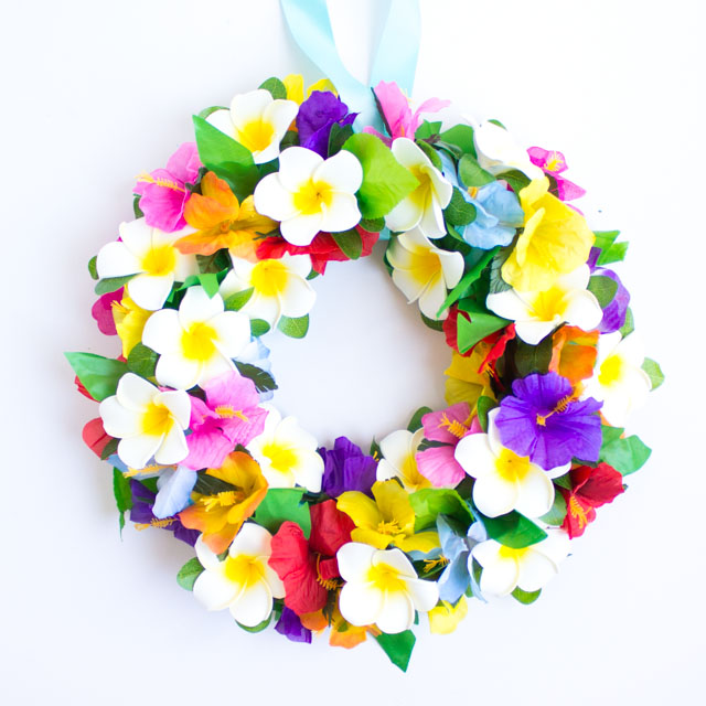 Make this tropical flower wreath for your front door this summer! It would also be perfect for a luau or pool party!