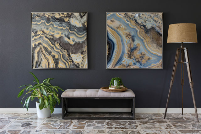 Create a high impact focal wall with large scale art and dark paint.