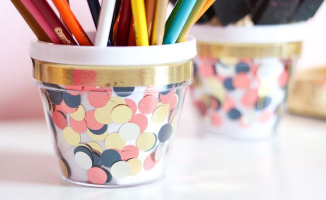 Add some stylish storage to your desktop with these fun DIY confetti desk organizers!