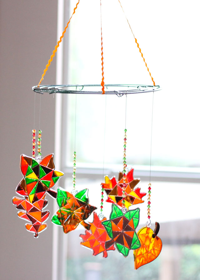 This autumn leaf suncatcher mobile is the perfect fall kids craft!