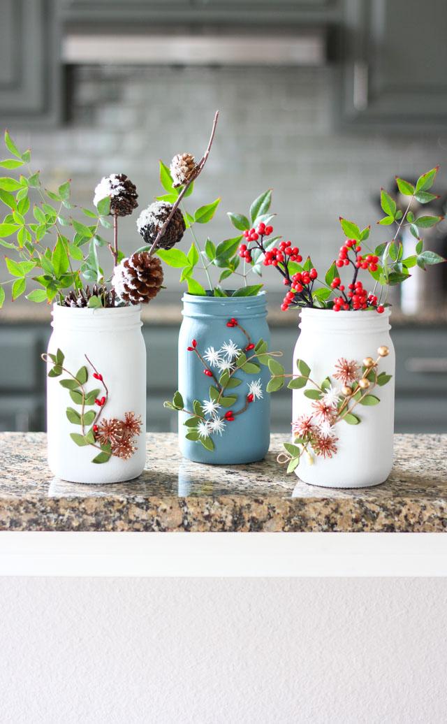 Such a pretty mason jar craft idea - winter floral vases!