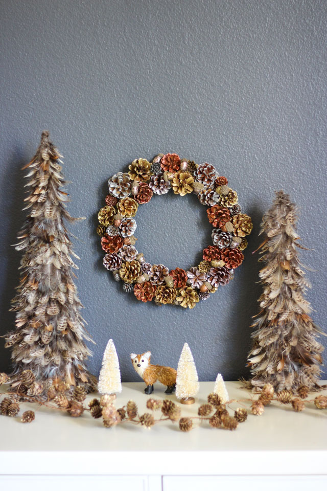 Paint pinecones and acorns in a variety of glittery metallics for this glam Christmas wreath idea!