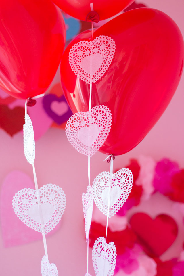 Use paper heart doilies to decorate balloons for Valentine's Day!