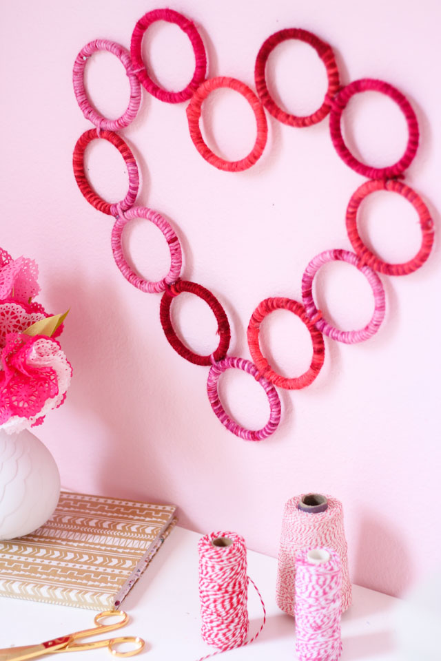 Make this yarn-wrapped heart wreath for under $10. Perfect for a Valentine's Day gift idea!