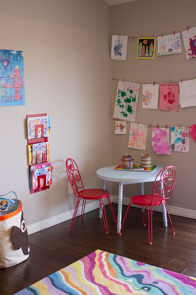 Colorful kids playroom with toy storage solutions