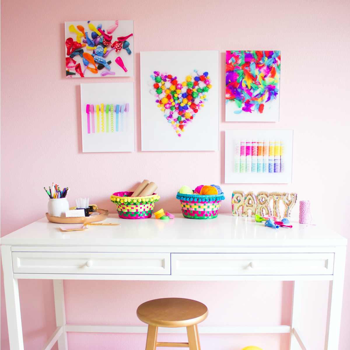 pink-craft-room-with-colorful-wall-art