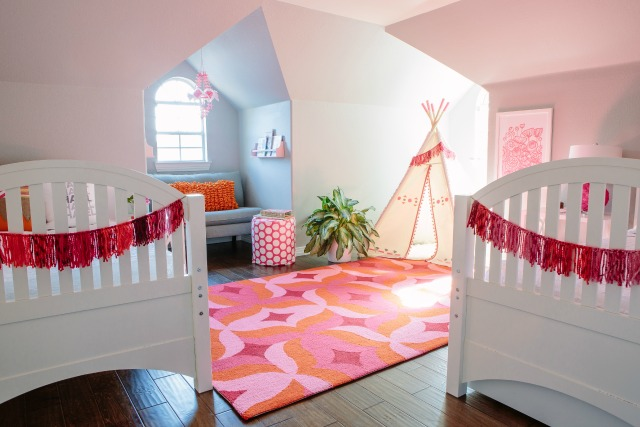 Girls shared bedroom with teepee and pink and orange decor