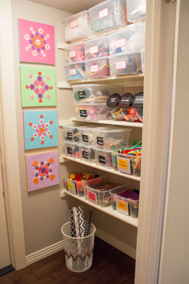 Craft closet organized with clear storage bins