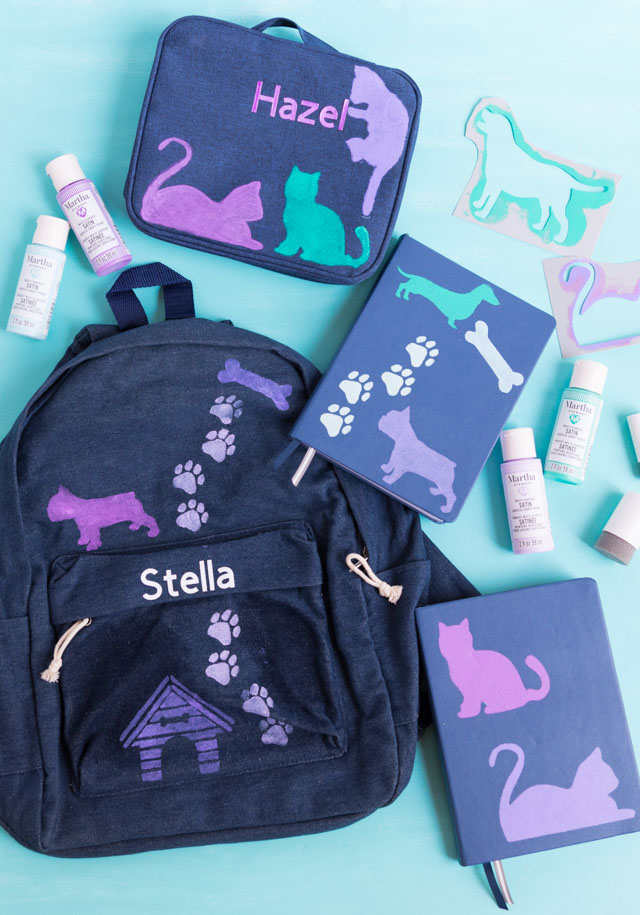 Kids backpack lunchbox and notebook decorated with cat and dog stencils