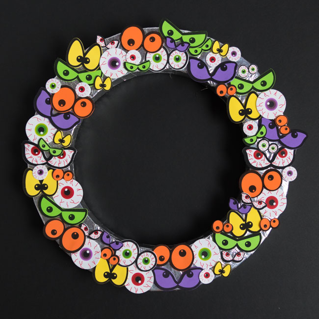Wreath form covered with eyeballs
