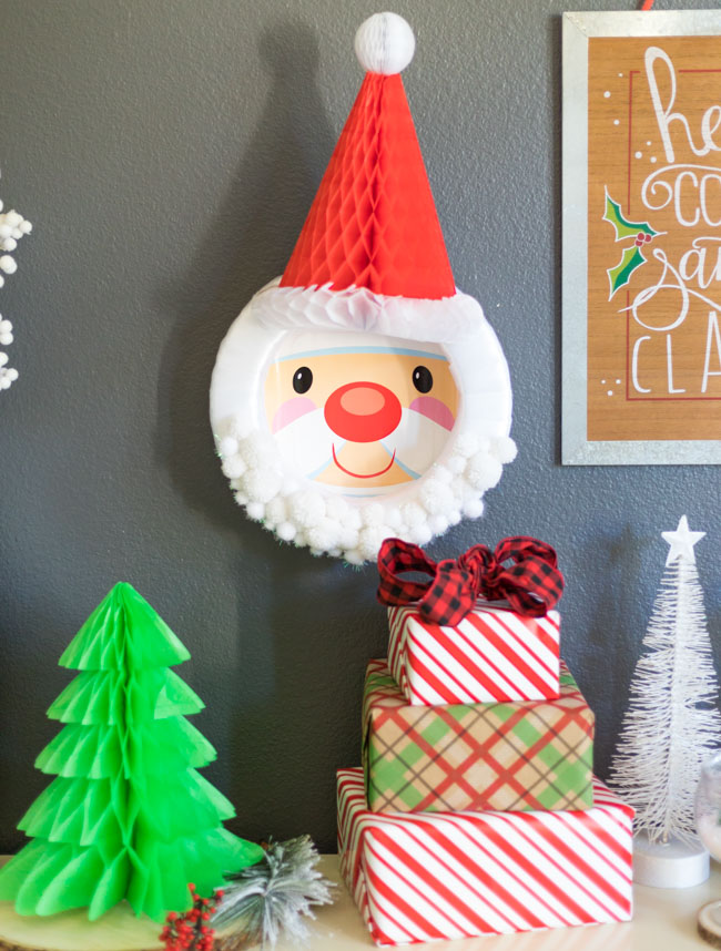 DIY Santa wreath with honeycomb hat and pom-poms