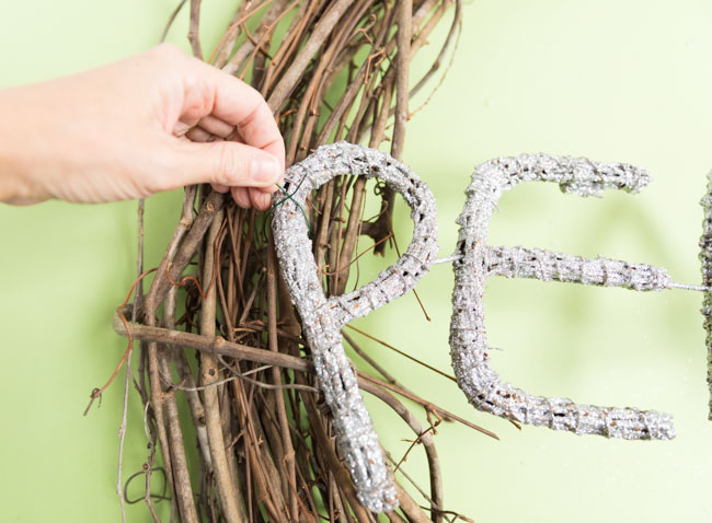 Wrapping floral wire around a grapevine wreath