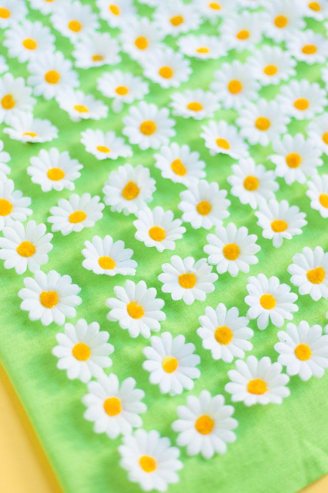 Artificial daisy flowers on a shirt