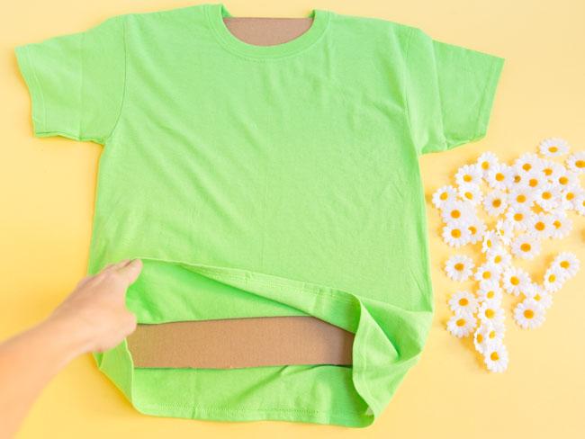 Inserting cardboard between shirt