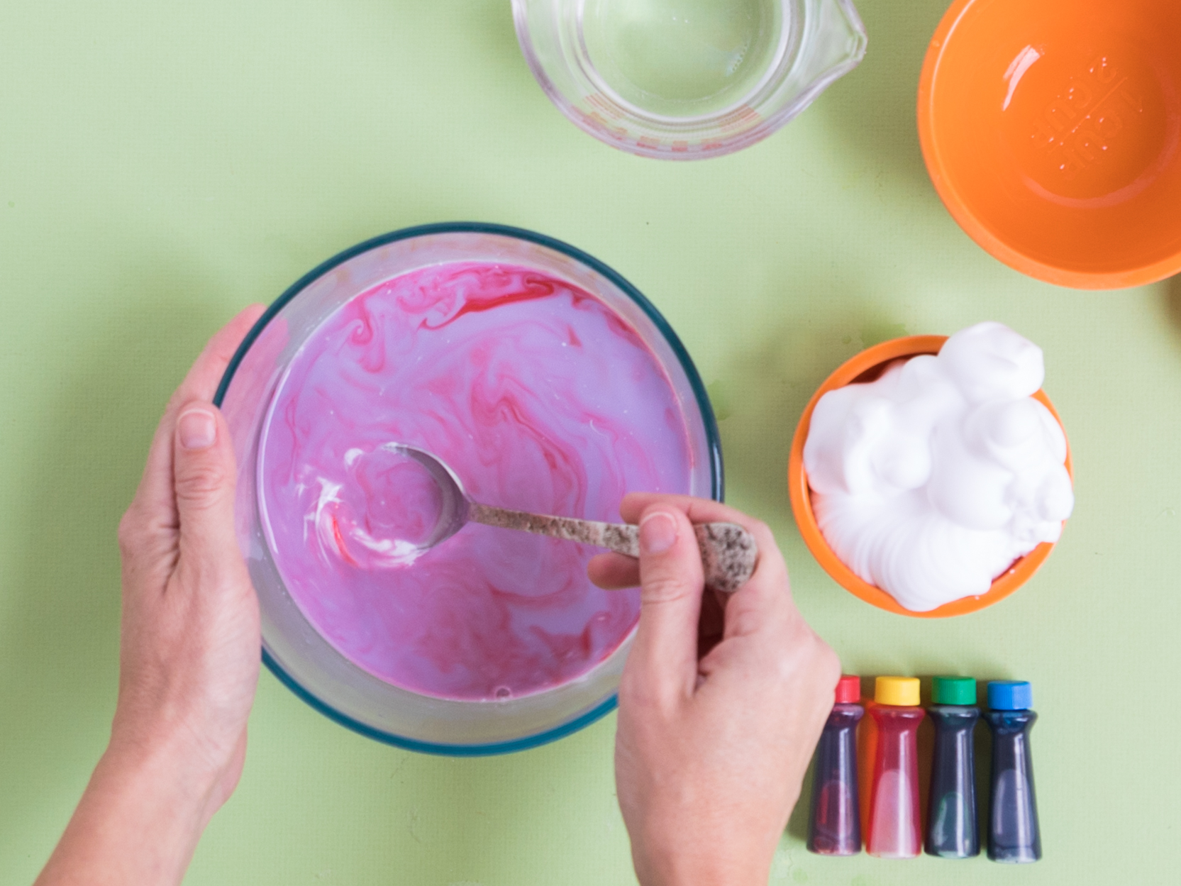 Adding food coloring to fluffy slime