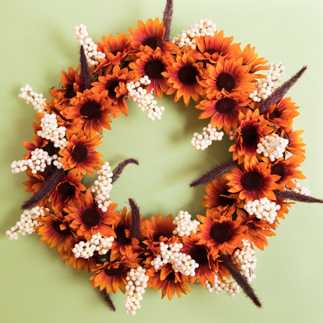 Fall wreath with sunflowers and cattails